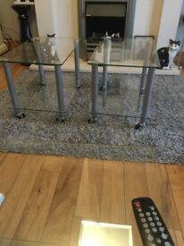 Lovely glass tables great condition glass two teir silver legs with wheels