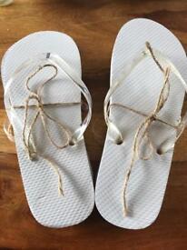White flip flops medium and large sizes