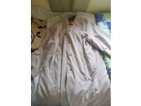 Size 14. Next cream rain coat.