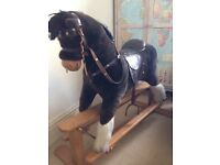 Mama and Papas rocking horse. Good condition apart from slightl matted hair on mane and tail