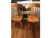 Two solid dining chairs