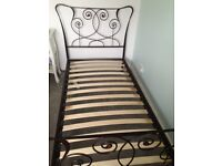 Black single bed frame with amber glass