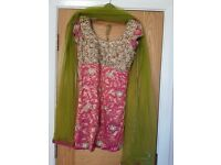 Short kurta Churidaar in pink and green with embroidery