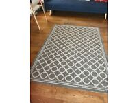 Beige and cream patterned rug