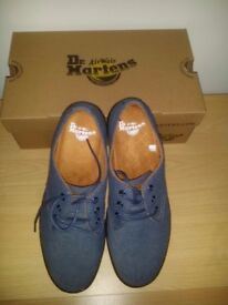 Brand new, unused Dr Martens men's light blue canvas shoes, one size only(UK 9) for sale.