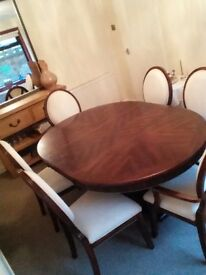 Beautifully carved dining table and chairs