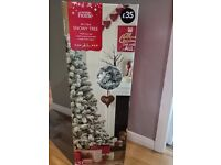 Selling snowy tree from George Home