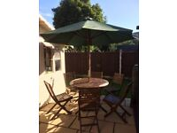 Garden Table, 6 Matching Chairs, Parasol & weighted Parasol Base