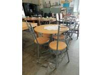 Circular four seater dining table with chairs