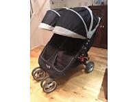 Baby Jogger City Mini Double Stroller in Black with footmuff and rain cover
