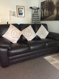 For sale a brown leather 3 and 1 seater sofa,