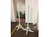2 white wooden supports