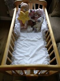 Wooden crib with mamas and papas mattress and bedding