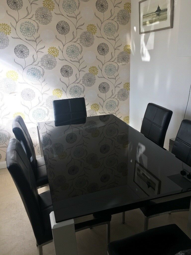 Glass top table and 6 chairs