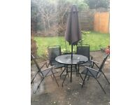 Black garden chairs and table (with parasole) £40