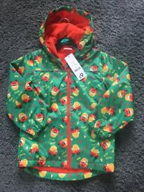 Brand new with tags boys fleece lined showerproof little tikes jacket age 5-6 years.