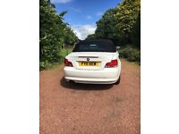 White BMW one series convertible