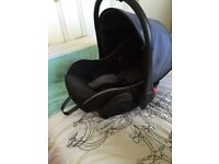 Car seat with isofix base and Venicci pram adapters
