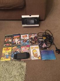 PSP piano black with 7 games and 2 movies all works fine with charger