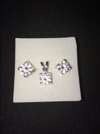 Silver set earrings studs and pendant