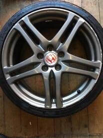 Honda Rage alloys with tyres.