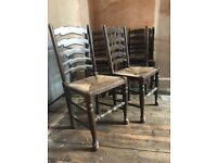 6 Dining Chairs; nice dark solid wood with grass weave seats