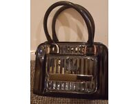 Ted Baker black patent handbag.