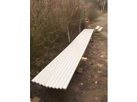 Light grey plastic coated corrugated roofing tin