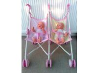 Baby Born twin interactive dolls with double buggy
