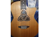 LUNA TRINITY 12 STRING GUITAR (Nearly new and in mint condition) with built in pick up and tuner.