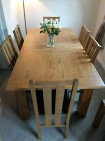 Solid Oak table & 6 leather chairs- sits 8