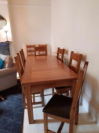 Dining room table and 8 chairs, large and we think its oak