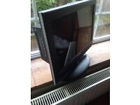 Flat screen 30inch with built in DVDs player. Hardly used immaculate condition