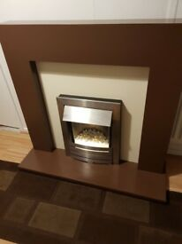 Electric fire with surround. H 113 cm W 116 cm D top 15 cm D bottom 38 cm
