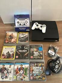 PlayStation 3 console with games and 2 controllers