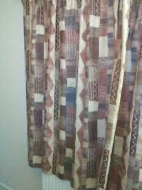 Pair of curtains lined John lewis material.