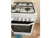 Free standing gas cooker with oven