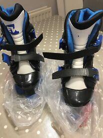 Quad skates size J13-2 (worn once inside)