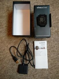 Garmin Vivoactive - Complete in original box with charger and instructions.