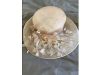 Wedding hat, nude colour with feather decoration