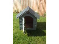 Sturdy warm wooden dog kennel for one large dog or two small dogs