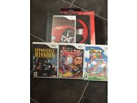 Brand new Wii games and steering wheel