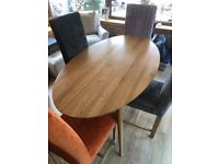 Dining table and covered chairs