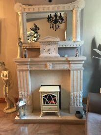Cream Stone fireplace with matching mirror plus clock.