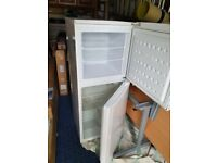 Fridge freezer and electric cooker
