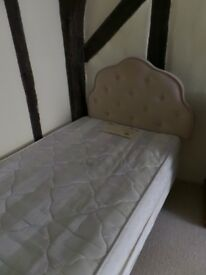 Free, single bed base, mattress included if desired.
