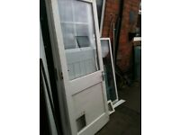 Exterior wooden door with clear d/glazed glass and cat flap hole