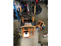 Petrol engine with power washer and generator attachment