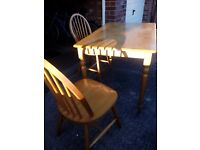 Table and 4 chairs, good condition, light wood finish