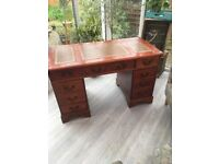 Traditional wooden desk with leather inlay top